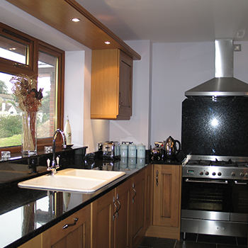 Black Angola granite with cooker backsplash, window sill and upstands - granitecraft shropshire