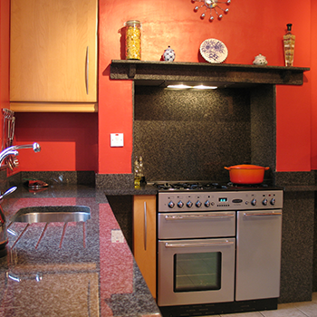 Bon Accord granite clading in the cooker resess and down to the floor - granitecraft shropshire