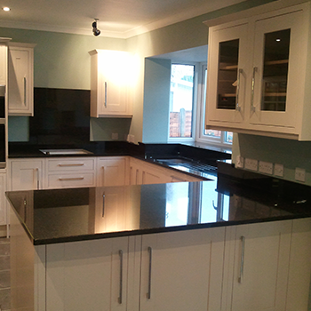 Bon Accord granite, cooker backsplash, window sill and breakfast bar - granitecraft shropshire