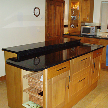 Dual tier island and breakfast bar in Black Angola granite - granitecraft shropshire