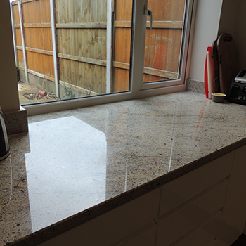 Ivory Fantasy granite flowing into the window sill - granitecraft shropshire