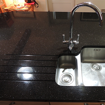 Polished sink cut out and drainage grooves, Star Galaxy - granitecraft shropshire