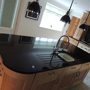 Star galaxy island with polished sink cut out an drainage grooves - granitecraft shropshire