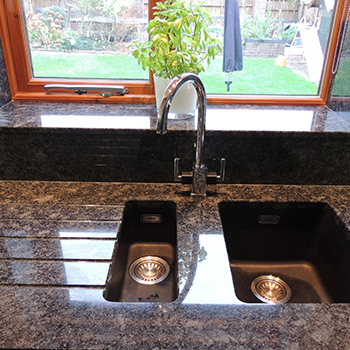 Steal grey granite with polished sink cut outs - granitecraft shropshire