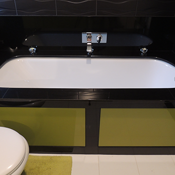 Supreem black granite over a bath,including bath frame and skirting - granitecraft shropshire