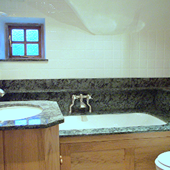 Tropical green granite, cladding, shelf, vanity top, over the bath - granitecraft shropshire